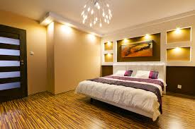 photo example of a master bedroom with modern wall lighting