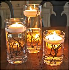 DIY Wedding Table Decoration Ideas tall candle pillars with flowers inside  and short mason jars with simple flowers. These will cluster in center of  table ...