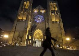 a pedestrian walks by the front of grace cathedral in san francisco calif