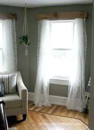 wooden window valance farmhouse bedroom wood above the window with dark gray walls and lace curtains wooden window valance