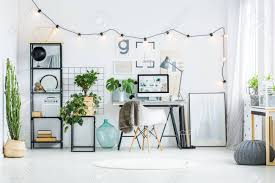 White home office design big white Ideas Home Office Design Concept Big Cacti On An Ecological Flower Pot In White Room With Line Of Light Bulbs On 123rfcom Big Cacti On An Ecological Flower Pot In White Room With Line
