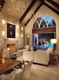 with two stunning yellow shade chandeliers and white upholstery sofa set and charming table lamp in white themed living room facing wonderful pool