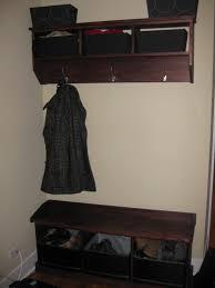 clothing hooks coat hook storage unit hook shelf unit with black storage baskets mounted by