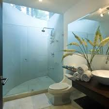 modern minimalist beachy bathroom design with folding table under mirror and shower room with blue mosaic wall tiles and glass room divider with door ideas