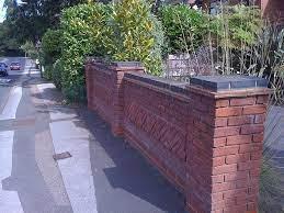 blue brick top to garden wall long