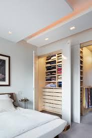 building shelves in closet with contemporary bedroom and ceiling platform closet doors closet drawers closet shelves cove lighting light wood drawers light