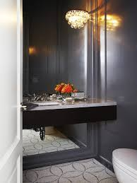black floating vanity on full length mirror
