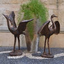 large outdoor metal crane statues for