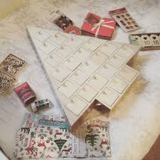 firstly lay your advent calendar on the floor or large table and cover the surfaces with paper remove all the draws and begin painting the outside of the