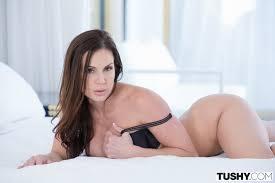 Busty Babe Kendra Lust Wearing Platform High Heels in Bed Image. Busty Babe Kendra Lust Wearing Platform High Heels