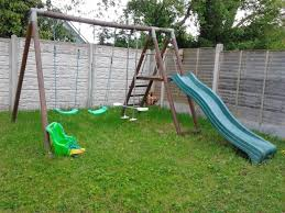 wooden double swing set with slide and see saw