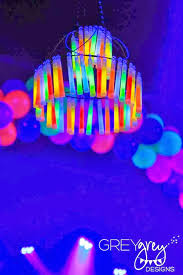 we re going to replace the lighting in the gym with black lights and have the lights off or low so the fun glow décor and dress up things are the focus