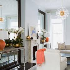 Console Table in Front of Floor Mirror view full size. Blue living room  with orange accents.