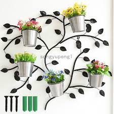 black metal wall mounted potted plants