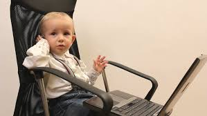 childs office chair. little businessman kid with laptop and mobile on office chair stock footage video 5601041 shutterstock childs