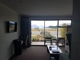 triple sliding glass doors that open to