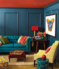 colorful living room. blue sofa and yellow chair combination for colorful living room design ideas with dark grey wall paint t