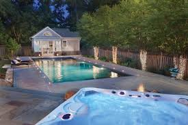 At the far end of the pool, a fire pit and hot tub beckon.
