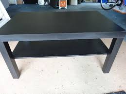 ikea black coffee table and black glass large tv stand two items