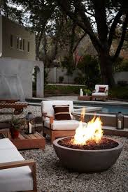 modern patio fire pit. Round Stone Fire Pit For Modern Patio Backyard Designs With Teak Armchairs Using White Cushions E