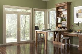 interior view of swinging patio door in a study leading to back yard