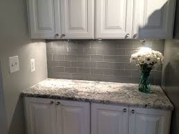 grey glass subway tile backsplash and white cabinet for small space kitchen with cabinets granite countertops 736x552 encouraging tiles home