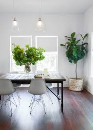 dark dining table with white chairs