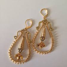 i m still pretty stuck on my wire working kick and after i created my wire wrapped silver chandelier earrings and wore them four times in one week i knew