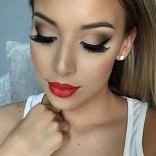 i love her red lips and how they are lined perfectly it goes great with