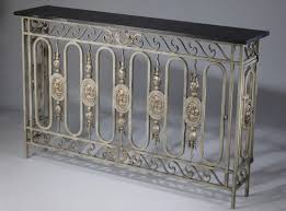 antique wrought iron french balcony in warm grey gold paint finish with dark marble top
