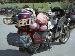 funny picture of overpacked motorcycle going on a trip