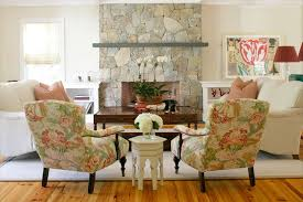 furniture s buffalo ny eclectic living room and area rug fireplace mantel fl arrangement fl print hydrangeas orchid roman shades stone