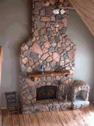Fieldstone fireplace made with concrete stone from our molds by Tim  McClelland.