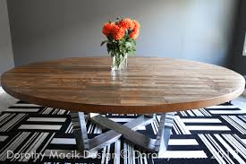 custom round strip wood dining table on stainless steel base butcher block and chairs for