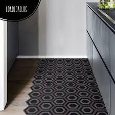 decorative vinyl to paste over floors and stairs of an elegant printed dark ceramic tiles pattern dark hexagonal ceramic