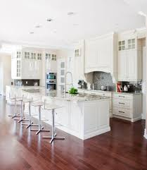 eat in kitchen furniture. A Rich Red Hardwood Floor Contrasts Beautifully With The White Cabinetry And Marble Countertops Of This Eat In Kitchen Furniture G