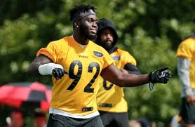 pittsburgh steelers linebacker ola adeniyi 92 warms up at practice during nfl football training