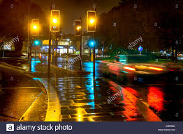Stop Light At Night Night Rain View Yellow Traffic Lights At Uk Roundabout Stock