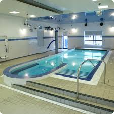 indoor swimming pool lighting. Spacious Indoor Swimming Pool Design With White Tile Wall And Ceiling Lighting Idea