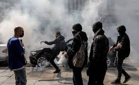 French police fire tear gas as anti-vaccine protest turns violent ...