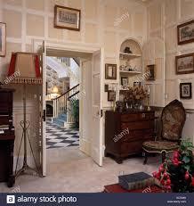 open double door drawing. Tapestry Chair And Antique Chest-of-drawers Beside Open Double Doors In Georgian Drawing Door 0