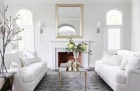 white sofas with an antiqued mirrored coffee table