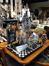 mackenzie childs rugs lifestyle image look alike black white checd piggy bank lane consignment room