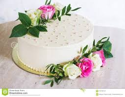 Beautiful Wedding Cake With Flowers On Marble Table And White