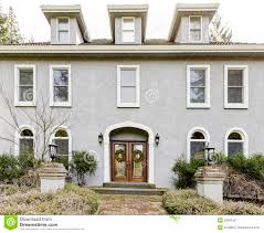 Home Exterior Of Large Grey Classic House With Many Narrow Windows - Exterior windows