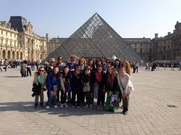 bonjour from paris spending spring break parisian style the  marian girls take the louvre marian french students pose at the louvre one of the