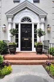 black front door pale gray painted brick white trim arched window cahill