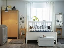 light bedroom furniture. a light medium sized bedroom furnished with white bed for two combined bedside tables furniture b