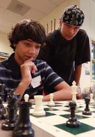 right both 14 work out a chess move together during a cl called chess challenge during the summer bridge program at west seattle high