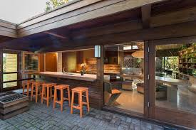 kitchen open to backyard patio midcentury with renovation high back outdoor bar stools